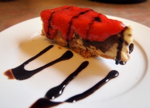 Chocolate Cheesecake with Strawberry Sauce